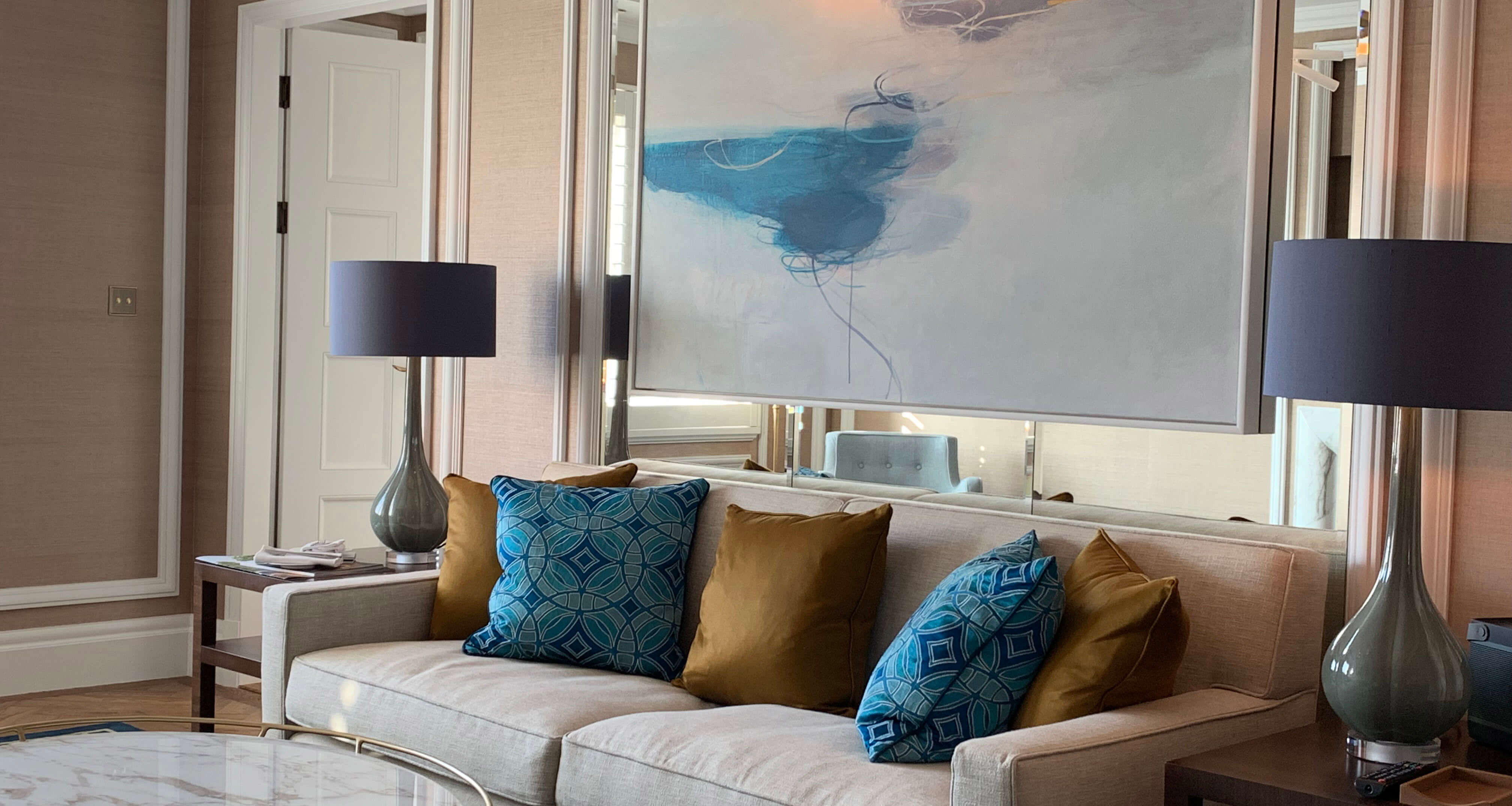 Cadogan hotel London suite with blue and gold cushions